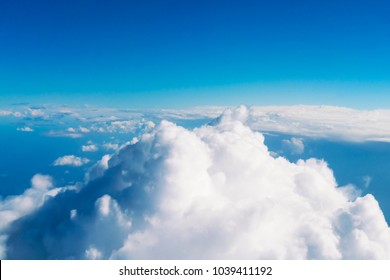 White fluffy clouds against a blue sky, background