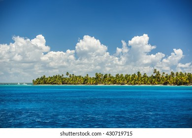 White fluffy clouds blue sky above a surface of the caribbean sea