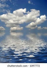 White fluffy clouds cumulus nimbus against a blue sky