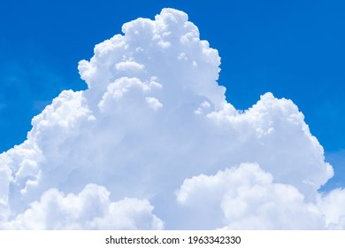 White fluffy clouds on blue sky. Soft touch feeling like cotton. White puffy cloudscape. Beauty in nature. Close-up white cumulus clouds texture background. Sky on sunny day. Pure white clouds. - Shutterstock ID 1963342330