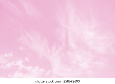 White fluffy clouds in the pink sky style