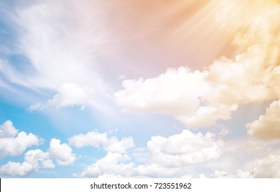 White fluffy clouds and sun background. A horizontal frame.