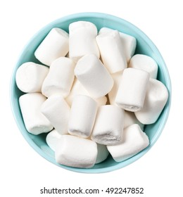 White Fluffy white marshmallows in blue bowl isolated on white background. Huge, big marshmallow macro top view image