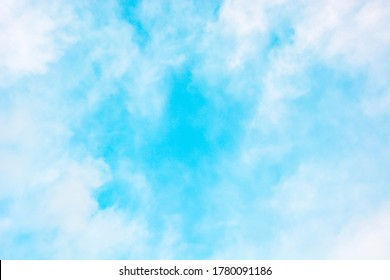 White fluffy soft cloud and bright blue sky background