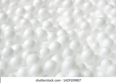 White foam balls background. styrofoam surface texture.