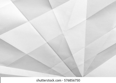 White folded sheet of paper showing an abstract texture design under the light grazing. Good to use as background