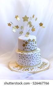White fondant cake with golden stars