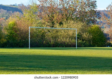 White football goalposts on a playing field