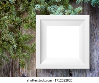 White frame and branch spruce amid a dark grey wooden wall, mock up