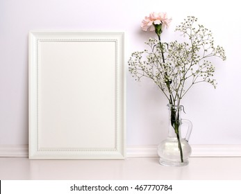 White frame mockup with flowers. Poster product design styled