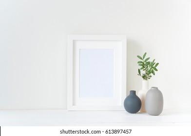 White frame mockup with vases composition