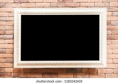 white frame on brick wall