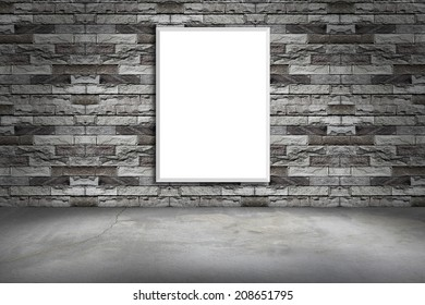 white frame on a brick wall and the concrete floor