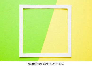 White frame on pastel green and yellow paper background. Bright, acid colors. Greeting card. Mockup for positive idea. Empty place for inspirational, motivation text, quote or sayings.