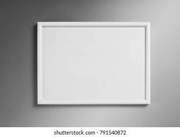 White frame for paintings or photographs on gray background
