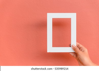 White frames in pink background.