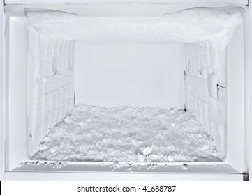 white freezer refrigerator is opened