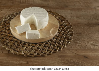 White and fresh cheese, on wooden table - traditional product of the State of Minas Gerais - Brazil.