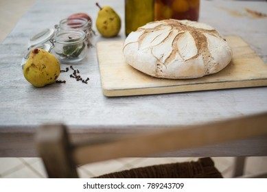 White freshly baked bread on a white rustic wooden table. Concept of healthy genuine handmade food.