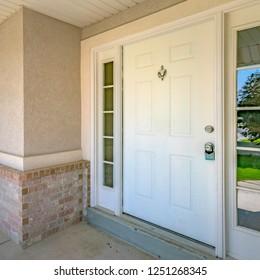 White front door with door knocker and glass panes
