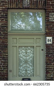White Front Door of a Red Brick Town House
