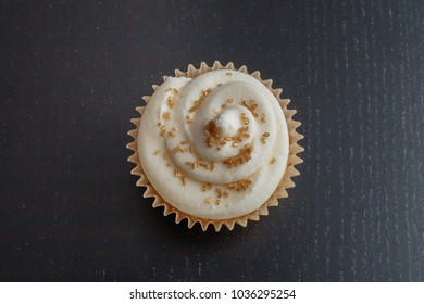 White Frosted Cupcake with Gold Sprinkles