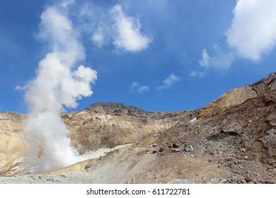 White fumaroles of the volcano Mutnovsky Kamchatka, Sunny summer day
