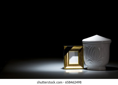 white funeral urn on dark background