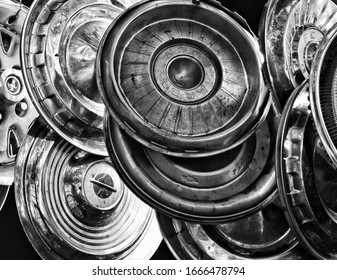 White, GA / USA - October 17, 2018: A Group of Old Scrap Automobile Hubcaps Displayed in a Junkyard