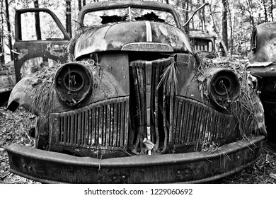 White, GA / USA - October27, 2018 - Close-up Image of the Front of an Old Studebaker Truck in a Junk Yard
