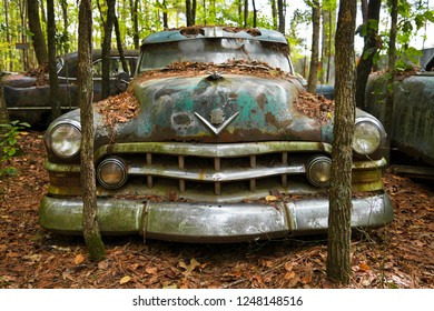 White, GA / USA - October27, 2018 -Close-up Image of the Front of an Old Scrap Car in a Junk Yard