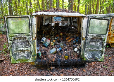 White, GA / USA - October27, 2018 - Image of the Back of a Scrap Van in a Junk Yard that is full of Old Oil Cans