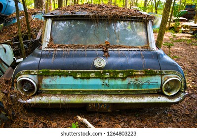 White, GA / USA - October27, 2018 - Close-up Image of the Rear of an Old Scrap Station Wagon in a Junk Yard