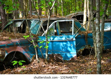 White, GA / USA - October27, 2018 - Close-up Image of an Old Scrap Car in a Junk Yard