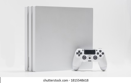 White game console and controller on with background