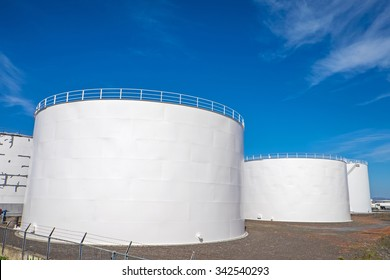 White gas storage tanks in the harbor of Reykjavik, Iceland