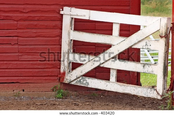White gate leading to a red barn in Gettysburg, PA.