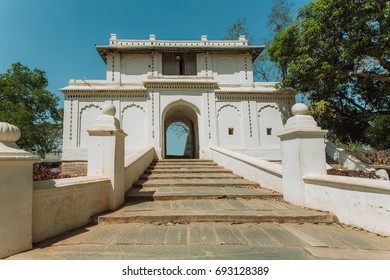 White gates in traditional indian architecture style. Old stairs and arch in historical India.
