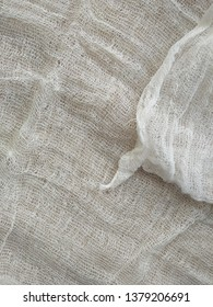 White gauze texture close up for background. Texture of white gauze fabric for the background. Cheesecloth texture. Background of natural cotton gauze.