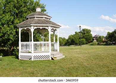 White gazebo in the grass