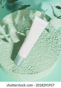 Tube crème générique blanc sur fond vert texturé sur fond monochrome. Hydratant, produit cosmétique à gomme naturelle
