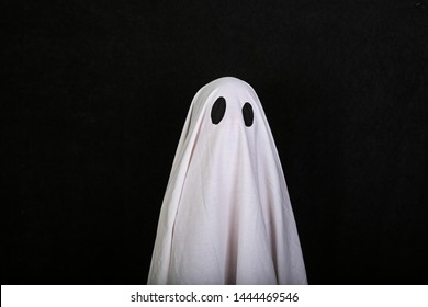 White Ghost on black background. Halloween holiday party