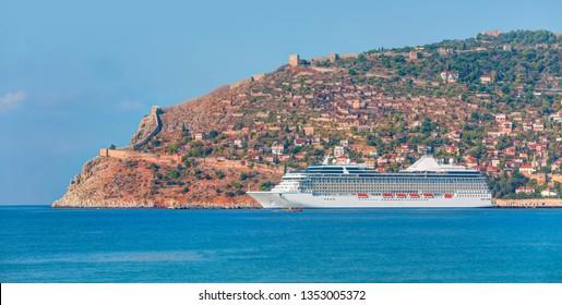 White giant luxury cruise ship on stay at Alanya harbor - Alanya, Antalya