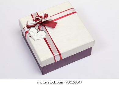 White gift box with bow on white