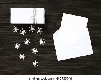 White gift box and envelope with greeting card