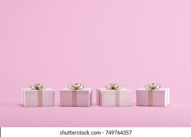 White Gift box on paste pink background. Christmas minimal concept idea.