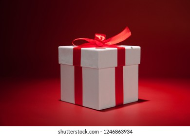 White gift box on red background. Copy spase