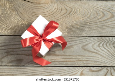 white gift box on wooden background