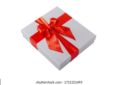 A white gift box with a red ribbon isolated on white background.