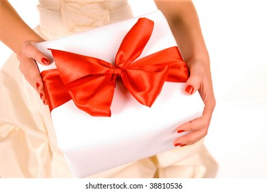 White gift box with red ribbon isolated on white.  The file includes clipping path.
